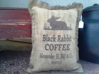 Pillow with Black Rabbit Coffee Written on it