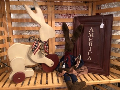 Wooden rabbit on wheels, americana rabbit, and red wooden sign board with America painted on it in white